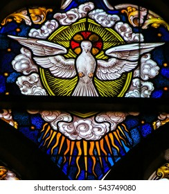 GHENT, BELGIUM - DECEMBER 23, 2016: Stained Glass depicting the Holy Spirit as a Dove, in the Cathedral of Saint Bavo in Ghent, Belgium.