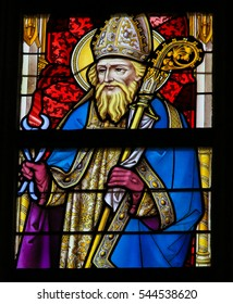 GHENT, BELGIUM - DECEMBER 23, 2016: Stained Glass window depicting Saint Dunstan in the Cathedral of Saint Bavo in Ghent, Flanders, Belgium.