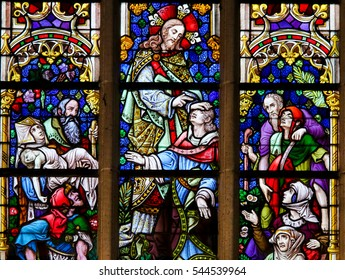 GHENT, BELGIUM - DECEMBER 23, 2016: Stained Glass depicting Miraculous Healings by Jesus Christ in the Cathedral of Saint Bavo in Ghent, Flanders, Belgium.