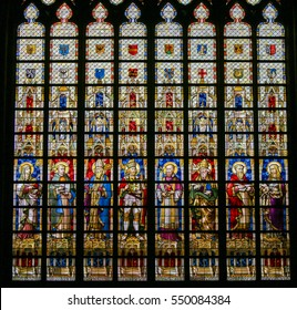 GHENT, BELGIUM - DECEMBER 23, 2016: Stained Glass depicting Catholic Saints in the Cathedral of Saint Bavo in Ghent, Belgium.