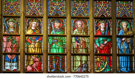 GHENT, BELGIUM - DECEMBER 23, 2016: Stained Glass window in the Cathedral of Saint Bavo in Ghent, Flanders, Belgium, depicting Catholic Saints
