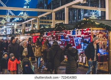 Ghent, Belgium - December 30th, 2016. Gent city winter festival in Flanders. Christmas fair with stalls, illumination, garlands and festive decorations near historical buildings on the Ghent Old town.