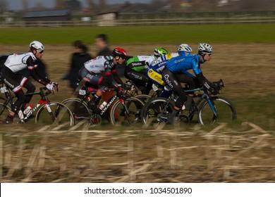 GHENT, BELGIUM - FEBRUARY 24:  The peleton racing over the Haaghoek in Omloop Het Nieuwsblad on February 24th, 2018 in Belgium