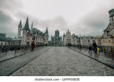 GHENT, BELGIUM - FEBRUARY 8 2020: Historic street and buildings of Ghent, in Belgium.