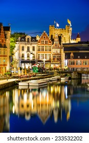 Ghent, Belgium. Graslei water channel with reflection Gravensteen Castle in night, Flanders