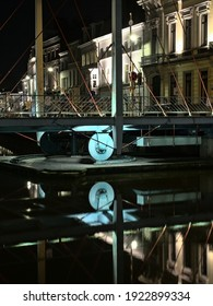 GHENT, BELGIUM, JANUARY 22, 2021, Illuminated Predikherenbrug, cable stayed swing bridge over river Lys at night, with reflections in the water surface in Ghent, 22 January 2020
