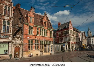 Ghent, Belgium - July 03, 2017. Street with old typical building and blue sky in Ghent. In addition to intense cultural life, the city is full of Gothic and Flemish style buildings. Northern Belgium.