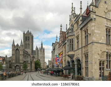 GHENT, BELGIUM - JUNE 2018: Beautiful cityscape of Gent with people walking in historic centre of Ghent near the St Nicholas (Sint-Niklaaskerk) church, Belgium