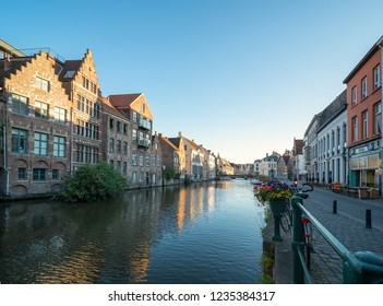 GHENT, BELGIUM - JUNE 2018: Old buildings with the canal in Ghent, Belgium. Ghent is one of Europe most underrated, if not unknown, medieval cities.