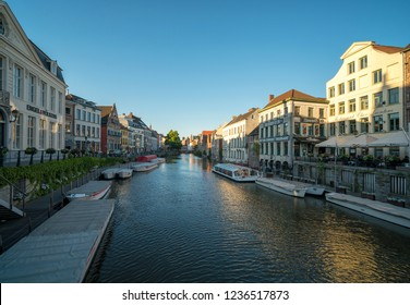 GHENT, BELGIUM - JUNE 2018: Old buildings with the canal in Ghent, Belgium. Ghent was founded in the 10th century and became the capital of the medieval principality of Flanders.