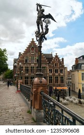 GHENT, BELGIUM - JUNE 2018: Statue of Archangel Michael, hitting with his spear the devil in the guise of a dragon on the bridge of Saint Michael in Ghent, Belgium