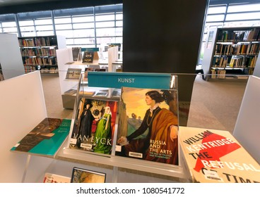GHENT, BELGIUM - MAR 30, 2018: Art books on showcase inside the new public library De Krook on March 30, 2018. Ghent is capital city of the East Flanders province