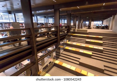 GHENT, BELGIUM - MAR 30, 2018: People reading books inside the new public library De Krook with bookshelves and lounge on March 30, 2018. Ghent is capital city of the East Flanders province