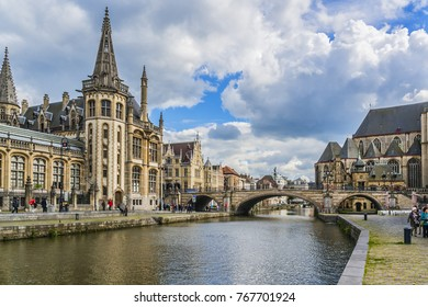 GHENT, BELGIUM - MAY 12, 2014: View of historical center of Gent with picturesque medieval gabled houses along canal. Ghent is a city and a municipality located in the Flemish region of Belgium.
