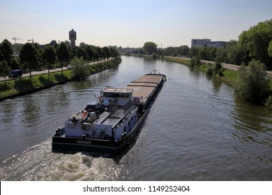 Ghent, Belgium - May 27, 2015: Inland cargo boat navigates on Ring Canal in Ghent, Belgium