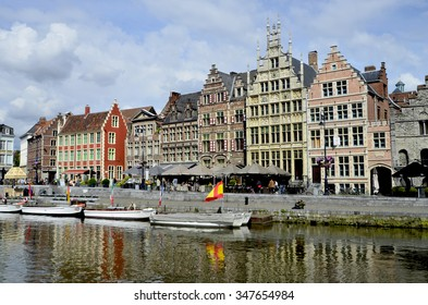 GHENT, BELGIUM - MAY 31: Unidentified people, restaurants and buildings on Graslei district along river Leie, a Unesco world heritage site, on May 31, 2011 in Ghent, Belgium