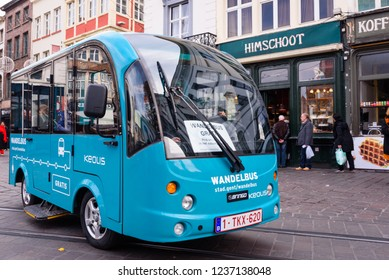 GHENT, BELGIUM. Nov. 9, 2018. Free electric hop-on, hop-off city bus (Gratis Wandelbus) in historical city center of Ghent. The bus drives tourists, elderly,... in the city center of Ghent, Belgium.