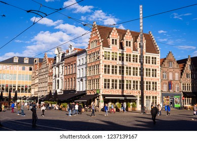 GHENT, BELGIUM. Nov. 9, 2018. People on city center square (Korenmarkt) of historical Flemish Belgian city Ghent. Artwork HD 400 by Ann Veronica Janssens on main square Korenmarkt, Ghent, Belgium.