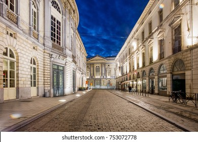 GHENT, BELGIUM – NOVEMBER 11, 2017. When the sun sets, the city lights up again. The Ghent lighting plan kicks in as thousands of lights are switched on – Opera & Law Courts, Ghent, Belgium
