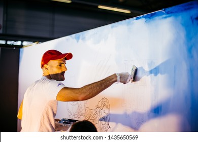 Ghent, Belgium - October 22, 2017: Live art performance by Belgian artist Ben Heine at FACTS Comic Con for the official release of Justice League Movie in Belgium. 7m x 2m traditional painting.
