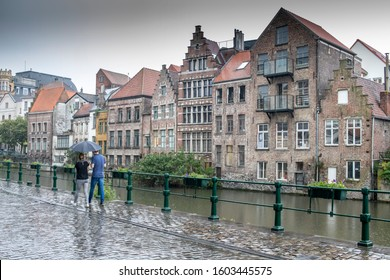 Ghent, Belgium October 28, 2019. The cobbled streets of the city shining in the rain at nightfall are one of the attractions most valued by the thousands of tourists who visit it daily