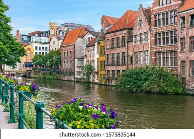Ghent, Belgium. Picturesque canal with old houses and flowers.