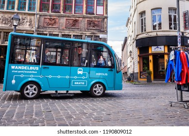 GHENT, BELGIUM. SEPT. 28, 2018. Free electric hop-on, hop-off city bus (Gratis Wandelbus) in historical city center of Ghent. The bus drives tourists, elderly,... in the city center of Ghent, Belgium.