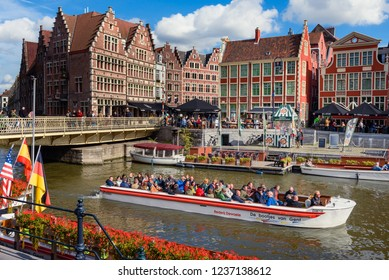 GHENT, BELGIUM. Sept. 28, 2018. Tourists on a boat on channel at Graslei en Korenlei in Historical city center of Flemish city Ghent. Ghent, Flanders, Belgium.