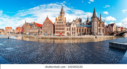 Ghent, Belgium, at sunset in spring. Historic city where you can see both Korenlei and Graslei as the river Lys (Leie) passes through the middle. Common place for tourists and students.