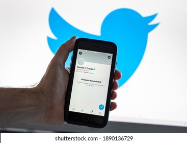 Ghent, East Flanders, Belgium - 01 09 2021: Screenshot of President Trump's blocked Twitter account on a mobile phone against a Twitter logo background