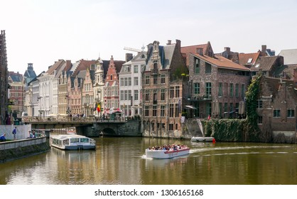 Ghent, East Flanders / Belgium - May 6, 2013: Tourist river cruises by the canal in the old city center