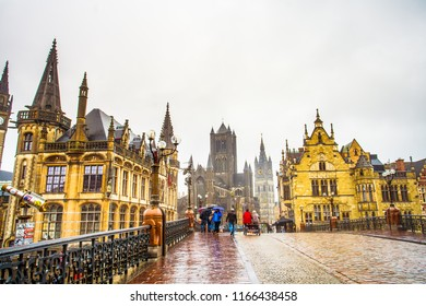 Ghent (Gent), Belgium - March 22, 2018 - Street view of St. Michael Bridge and Historical centre of Ghent around Korenmarkt square (Wheat Market), rainy day
