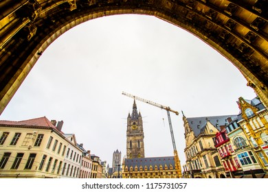 Ghent (Gent), Belgium - March 22, 2018 - Street view of Sint Baafsplein square with Belfry of Ghent in the historic city center of Ghent (Gent)