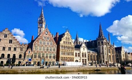 Ghent medieval city,  View of Graslei, Korenlei Streets, Korenmarkt, Post Office, Clock Tower over Leie river. Ghent, Belgium.