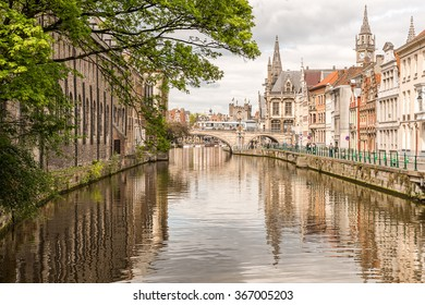 Ghent Old Town Architecture Cityscape and Canal Reflection. View of picturesque houses along channel in Ghent. Ghent is a city and a municipality located in the Flemish region of Belgium.