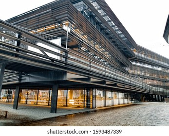 Ghent/Belgium - Dec. 13, 2019: The modern building of the city's new library, which has become the new pride of Ghent. It's a rainy afternoon.