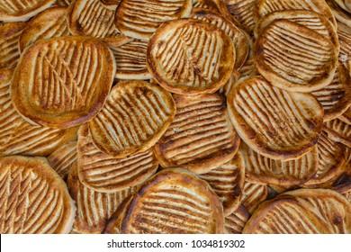 Ghev czhot or Ghee ki roti is a traditional Kashmiri bread freshly baked in Srinagar, Jammu and Kashmir, India. Bread background.