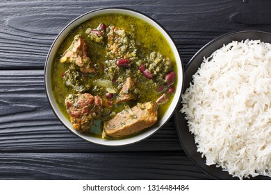 Ghormeh Sabzi Persian Herb Stew with meat and beans closeup in a bowl on the table. horizontal top view from above