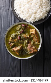 Ghormeh Sabzi Persian Herb Stew with meat and beans closeup in a bowl on the table. Vertical top view from above