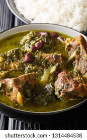 Ghormeh Sabzi Persian Herb Stew with meat and beans closeup in a bowl on the table. vertical