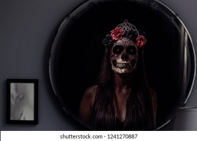 The ghost of Bloody Mary appears in a vintage mirror. Spooky, creepy phantom apparition. Inspired by a popular urban myth.