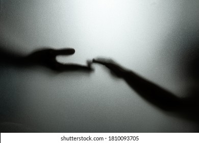 Ghost concept shadow of hand behind the matte glass blurry hand and body soft focus