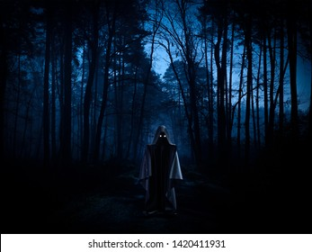 Ghost in a dark forest - spooky, horror or ufo concept