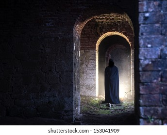 Ghost at the end of a corridor in old castle
