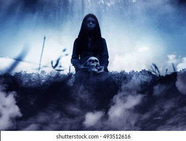 Ghost girl with human skull in hand,Scary background for halloween and book cover ideas