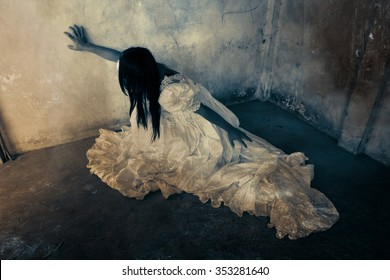 Ghost in Haunted House,Mysterious Woman in White Dress in Abandon Building,Horror Background For Halloween Concept and Book Cover Ideas