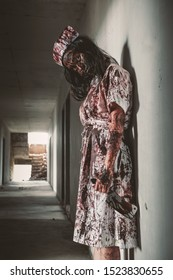 Ghost nurse woman or zombie holding the knife with resentment and malice in the building abandoned hospital.