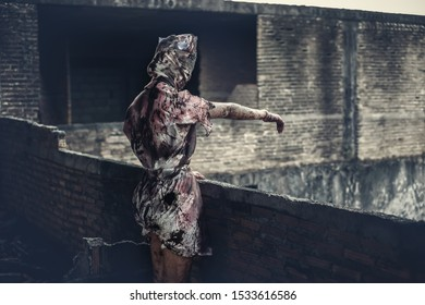 Ghost nurse woman or zombie standing waved hand to outside in the building abandoned hospital.