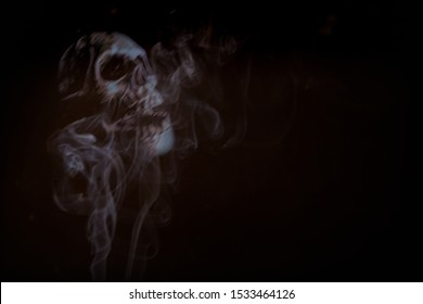 Ghost skulls horror background with a mist