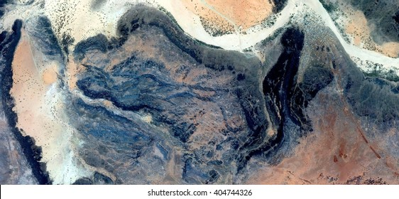 ghost stone head,abstract photography of the deserts of Africa from the air, bird's eye view, abstract expressionism, contemporary art, Science fiction, optical illusions,